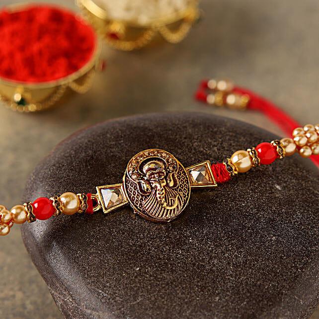 Mini Golden Ganesha Rakhi: Rakhi to Germany