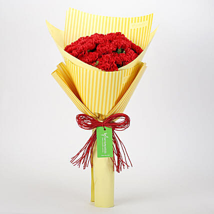 20 Red Carnations in Yellow Paper: