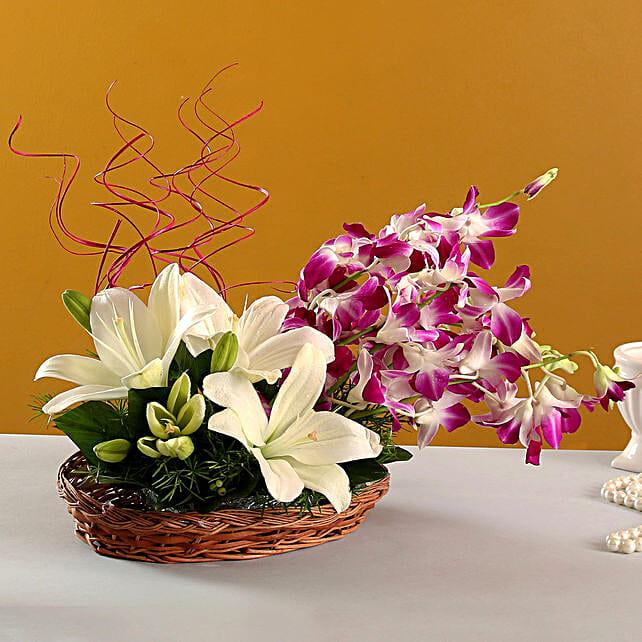 Lilies And Orchids Basket Arrangement: Mixed flowers
