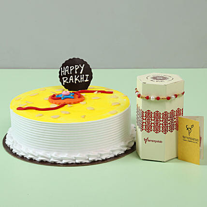 Fancy Rakhi & Designer Pineapple Cake: Send Rakhi with Cakes