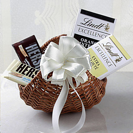 Lindt Chocolates Cane Basket Hamper: Bhai Dooj Gift Hampers