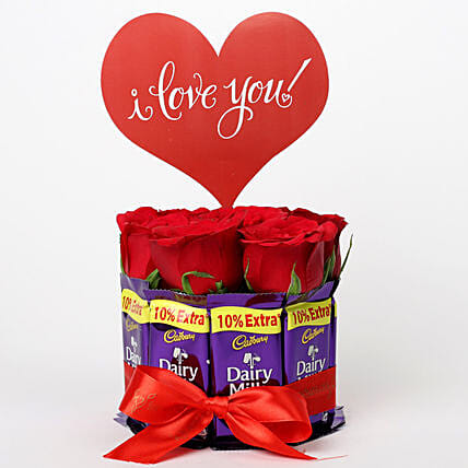 Red Roses in Glass Vase & Dairy Milk Arrangement: Chocolate Bouquet