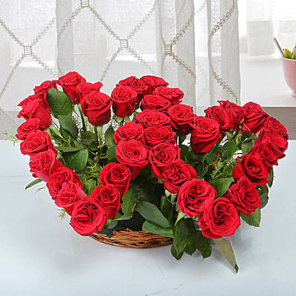 Two Red Hearts As One Basket Arrangement: Flower Arrangements