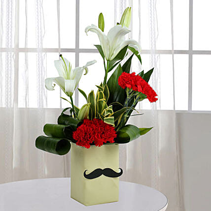 Red Carnation N Leaves Arrangement: Wedding Anniversary Gifts for Husband