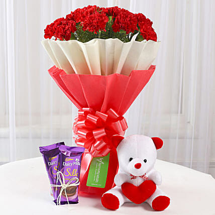 12 Red Carnations with Dairy Milk Silk & Teddy Bear: Flowers & Teddy Bears for Mothers Day