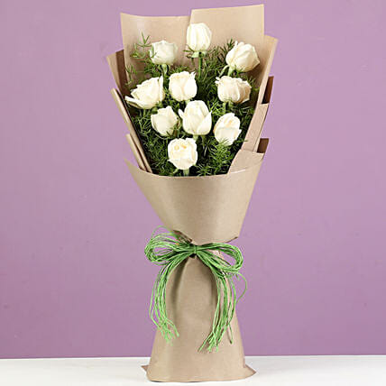 Serene White Roses In Brown Paper: Best Gifts to India