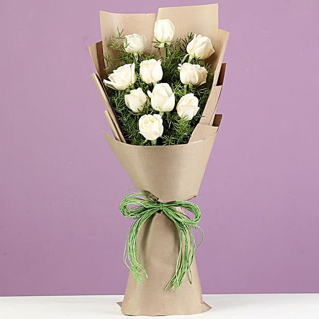 Serene White Roses In Brown Paper: