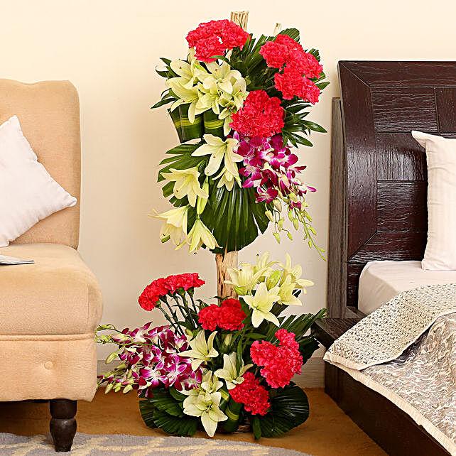 Orchids & Carnations Flower Arrangement: Basket Arrangements