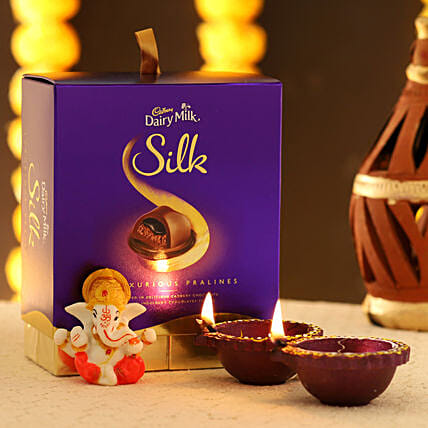 White Ganesha Idol & Dairy Milk Silk Box: Cadbury Chocolates