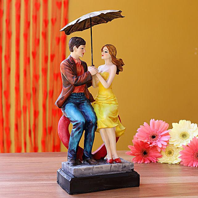 Couple Sitting On Heart Under Umbrella Figurine