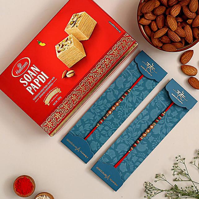 2 Pearl Mauli Rakhis And Soan Papdi With Almonds