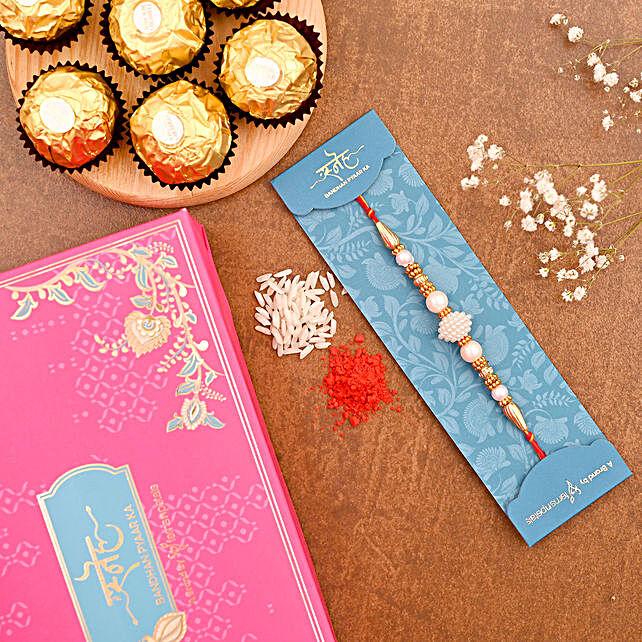 Elegant Pearl Mauli Rakhi And 3 Pcs Ferrero Rocher:Single Rakhi to Australia