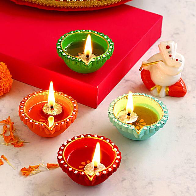 4 Colourful Diyas With Orange & White Ganesha Idol:Send Sweets to Australia