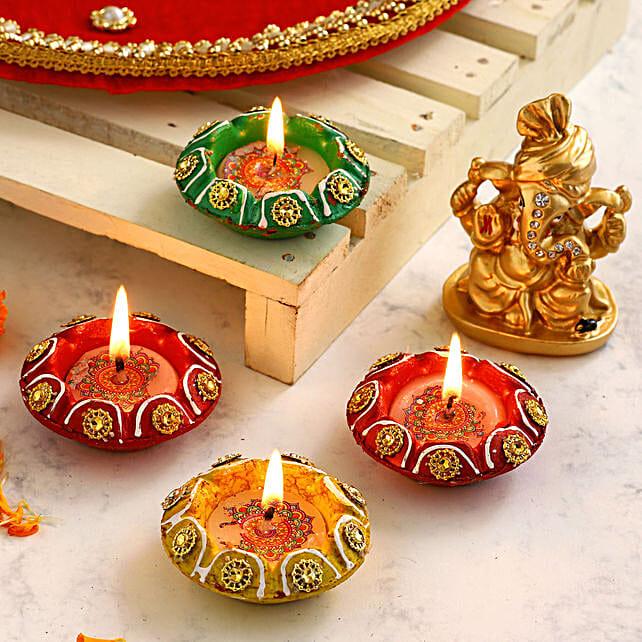 4 Designer Diyas & Golden Pagdi Ganesha Idol