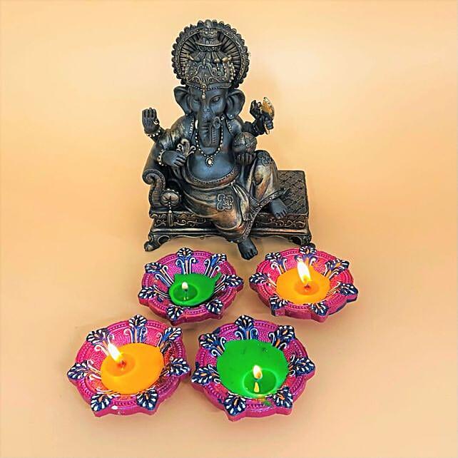 Set Of 4 Diyas With Sitting Ganesha Idol