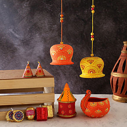 Diyas With Bells And Cracker Shaped Chocolates