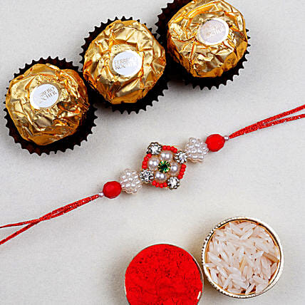 Appealing Floral Rakhi And 3 Pcs Ferrero Rocher
