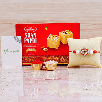 Appealing Floral Rakhi And Box of Soan Papdi:Rakhi With Greeting Cards to Canada
