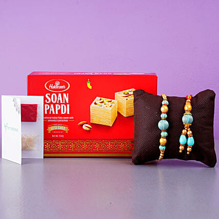 Blue Stone Rakhi Set And Soan Papdi Combo