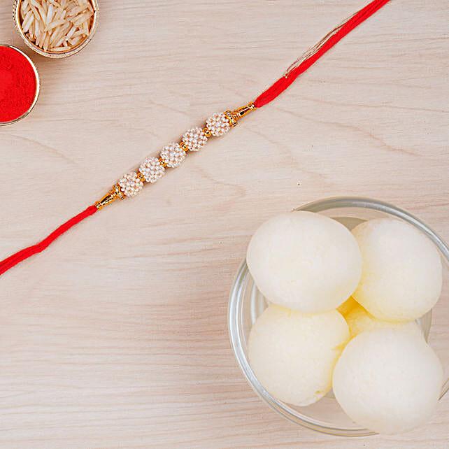 Elegant Pearl Thread Rakhi And Haldiram Rasgulla Tin