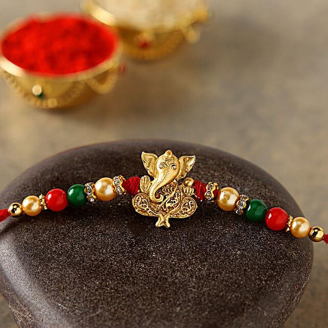 Golden Fancy Ganesha Rakhi:Single Rakhi to Canada