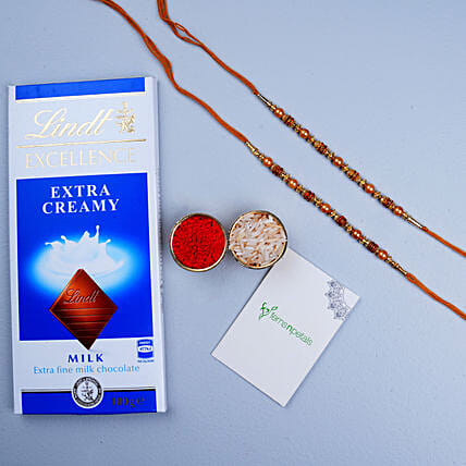 Golden Red Thread Rakhi And Lindt Chocolate