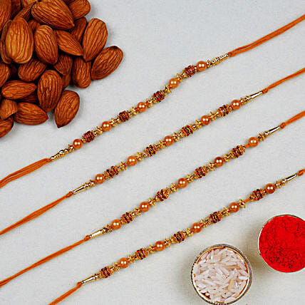 Golden Red Thread Rakhi With Almonds