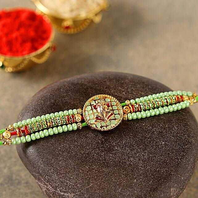 Gorgeous Pearl Ganesha Rakhi
