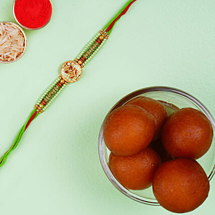 Green Ganesha Rakhi With Haldiram Gulab Jamun Tin