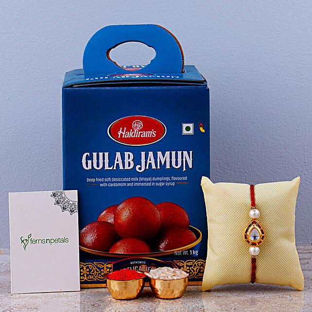 Beautiful Red Kundan Drops Rakhi And Gulab Jamun