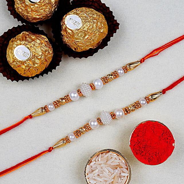 Divine Golden Pearl Thread Rakhi With 3 Pcs Ferrero Rocher:Pearl Rakhi to Canada