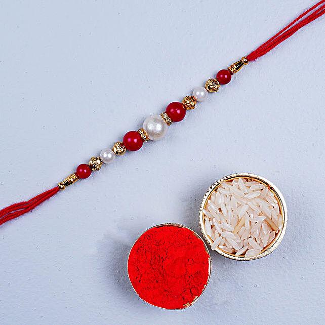 Fancy Red Thread Rakhi:Pearl Rakhi to Canada