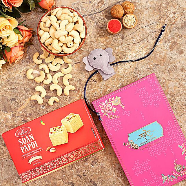 Elephant Kids Rakhi And Cashew With Soan Papdi