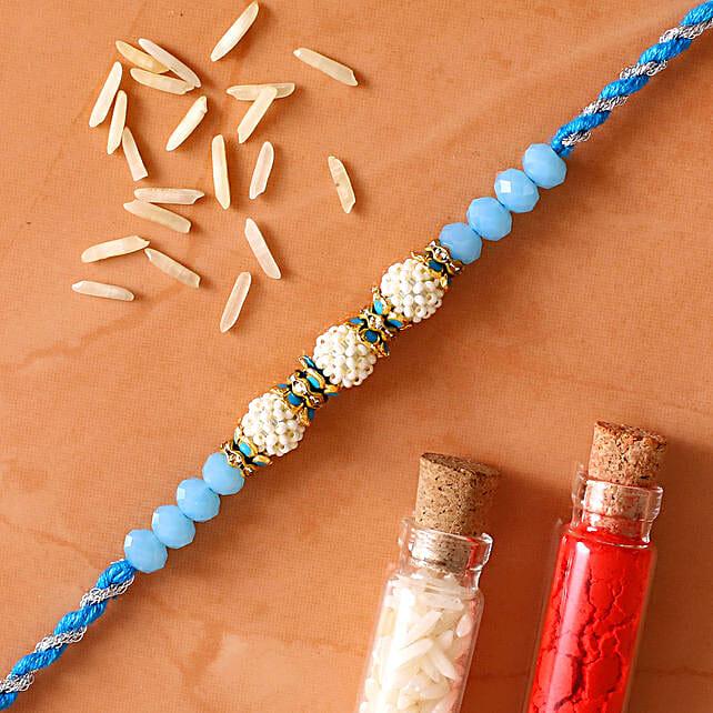 Sea Blue Pearl And Thread Rakhi
