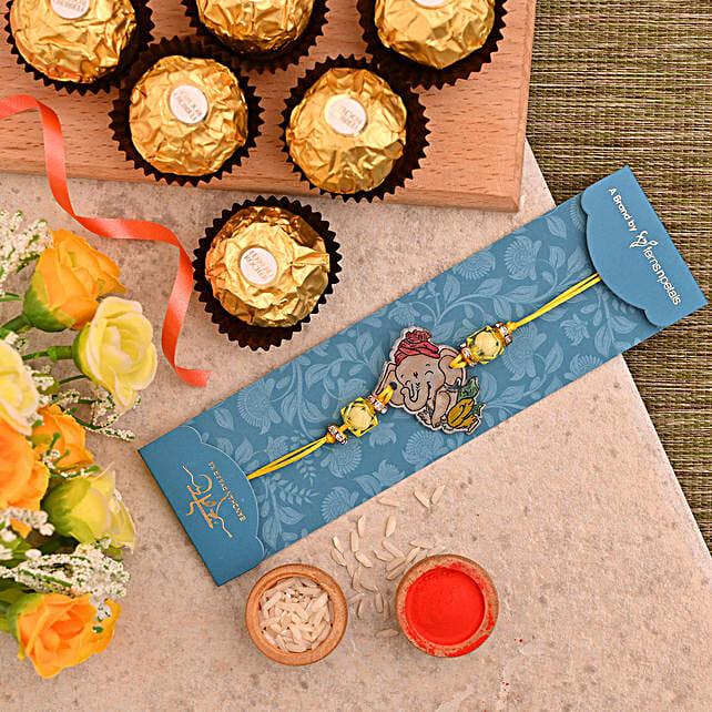 Divine Bal Ganesha Kids Rakhi And 3 Pcs Ferrero Rocher:Devotional Rakhi to Canada