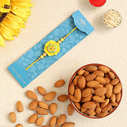 Yellow Flower Pearl Kids Rakhi And Healthy Almonds:Rakhi with Dry Fruits to Canada