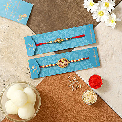 Om And Lion Face Rakhis With Rasgulla:Devotional Rakhi to Canada