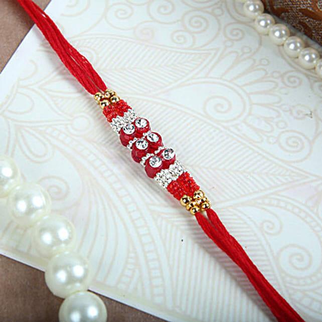 White Crystals N Red Thread Rakhi