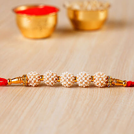 Fancy Golden Pearl Rakhi