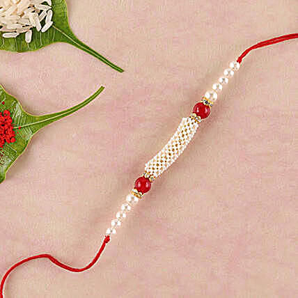Gorgeous White And Red Beads Rakhi:Rakhi With Sweets to China