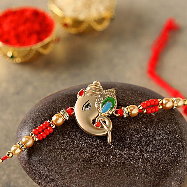 Alluring Rose Gold Ganesha Rakhi:Send Rakhi to China