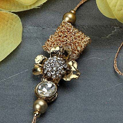 Delightful Antique Rakhi FIN