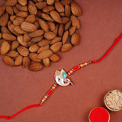 Alluring Rose Gold Ganesha Rakhi With Almonds