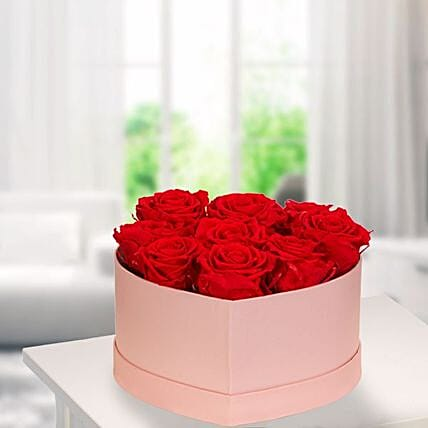 9 Red Roses In A Light Pink Heart Shaped Box