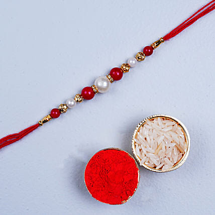 Fancy Red Pearl Thread Rakhi:All Gifts