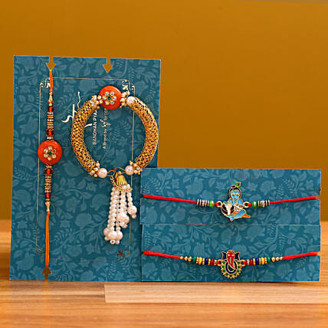 Krishna And Ganesha With Orange Pearl Lumba Rakhi Set