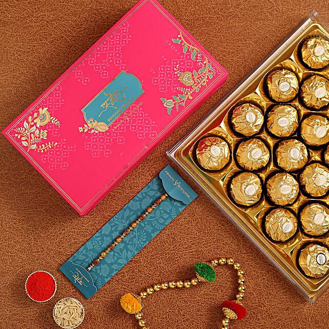 Traditional Golden Pearl Rakhi And 16 Pcs Ferrero Rocher:Rakhi  to Indonesia