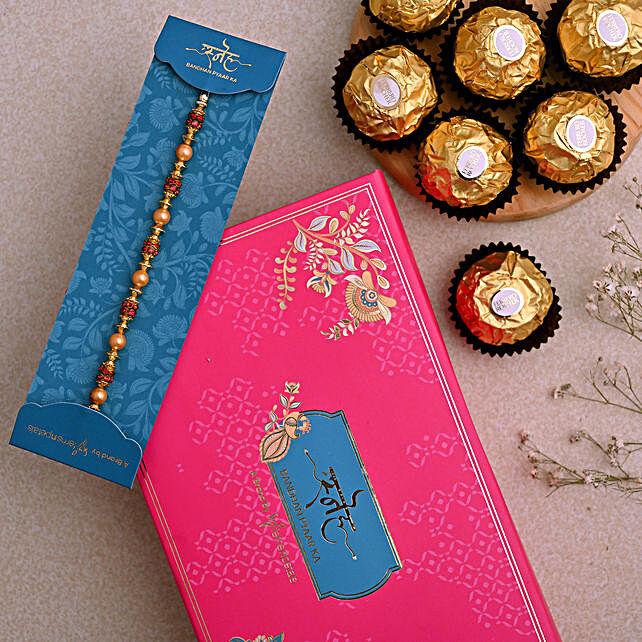 Traditional Golden Pearl Rakhi And 3 Pcs Ferrero Rocher