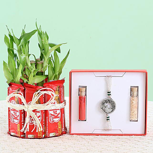 designer rakhi with sweet n green surprise