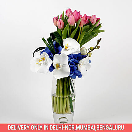 lovely colorful flowers with vase arrangement